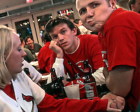 Jim Dohle, center, of Glen Carbon, and Aaron Bass, of Edwardsville, right, show their frustration during game 6 of the National League Championship Series against the New York Mets, as Abbey Pates, of Edwardsville, left, looks on, at Al Hrabosky's Sports Saloon. The St. Louis Cardinals lost the game 4-2 on Wednesday, October 18, 2006.