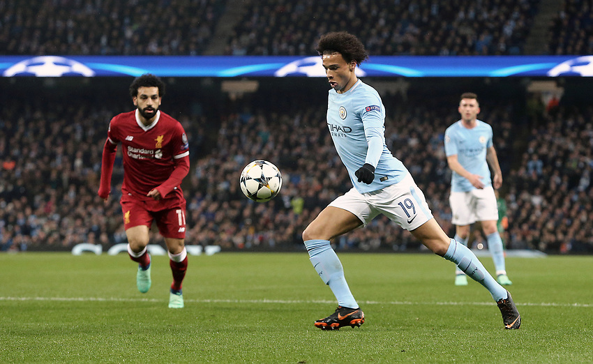 Manchester City's Leroy Sane crosses despite the attentions of Liverpool's Mohamed Salah<br /> <br /> Photographer Rich Linley/CameraSport<br /> <br /> UEFA Champions League Quarter-Final Second Leg - Manchester City v Liverpool - Tuesday 10th April 2018 - The Etihad - Manchester<br />  <br /> World Copyright &copy; 2017 CameraSport. All rights reserved. 43 Linden Ave. Countesthorpe. Leicester. England. LE8 5PG - Tel: +44 (0) 116 277 4147 - admin@camerasport.com - www.camerasport.com