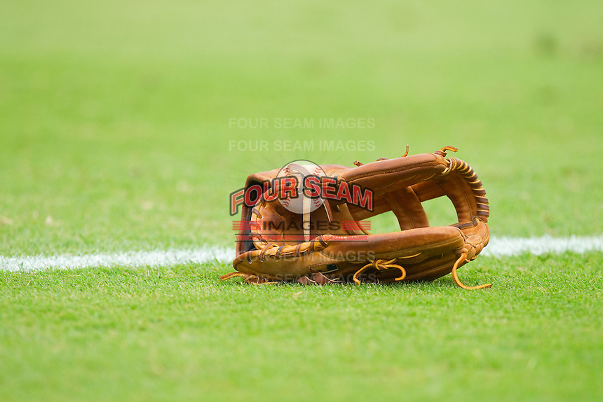 A baseball glove sits on the grass prior to the South Atlantic League game between the Lexington Legends and the Kannapolis Intimidators at CMC-Northeast Stadium on July 31, 2013 in Kannapolis, North Carolina.  The Intimidators defeated the Legends 3-2.  (Brian Westerholt/Four Seam Images)