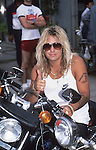 Vince Neil in Hollywood on Motorcycle in May 1987. Motley Crue at Video taping of Girls Girls Girls in Hollywood May 1987.