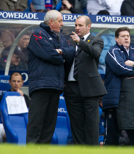 Gus MacPherson questions Walter Smith during the match