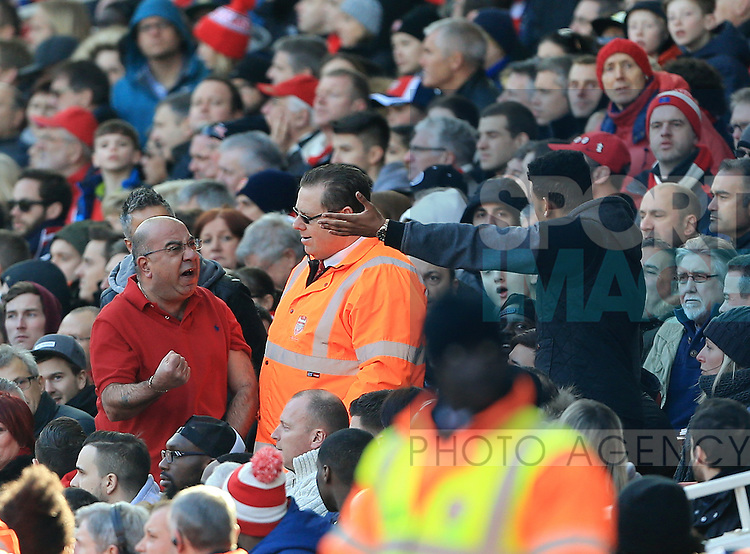 Arsenal's fans argue amongst themselves as Watford's second goal goes in during the Emirates FA Cup match at The Emirates Stadium.  Photo credit should read: David Klein/Sportimage