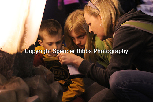 """Teacher and mother, Amy Robinson learned about learned about geological formations with her children Brady and Abbie Thursday afternoon at the new Museum of Science and Industry exhibit titled """"National Geographic Presents Earth Explorers."""""""