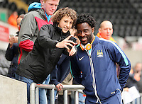SWANSEA, WALES - MAY 17: Wilfried Bony of Manchester City poses for a selfie as he arrives prior to the Premier League match between Swansea City and Manchester City at The Liberty Stadium on May 17, 2015 in Swansea, Wales. (photo by Athena Pictures/Getty Images)