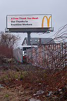 """A McDonald's ad on a billboard reads """"A free thank you meal: our thanks to frontline workers"""" in Medford, Massachusetts, on Mon., April 27, 2020 during the ongoing Coronavirus (COVID-19) global pandemic. Companies have modified most advertising to reflect the uncertainty of life during the pandemic and to show support for frontline workers, especially healthcare workers."""