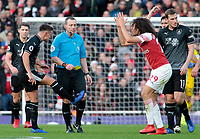 Arsenal's Matteo Guendouzi cannot believe it as he is shown a yellow card by Referee Kevin Friend<br /> <br /> Photographer David Shipman/CameraSport<br /> <br /> The Premier League - Arsenal v Burnley - Saturday 22nd December 2018 - The Emirates - London<br /> <br /> World Copyright © 2018 CameraSport. All rights reserved. 43 Linden Ave. Countesthorpe. Leicester. England. LE8 5PG - Tel: +44 (0) 116 277 4147 - admin@camerasport.com - www.camerasport.com