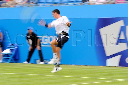 LONDON, UNITED KINGDOM, JUNE 7 2010:Jamie Baker (GBR) returns a Dennis Istomin (UZB) service during the 2010 Aegon Championships but loses his opening match 6-1, 6-4, at The Queens Club, London, United Kingdom.