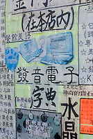 Detail of Advertisements and Notices on a Wall Outside of a Commercial Building in Chinatown, New York City, New York State, USA