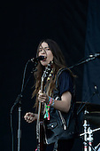 HAIM - Danielle Haim - performing live on the Pyramid Stage on Day One at the 2013 Glastonbury Festival held at Pilton Farm Pilton Somerset UK - 28 Jun 2013.  Photo credit: George Chin/IconicPix