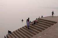 Indian men bathes at a ghat in Varanasi, Uttar Pradesh, India.