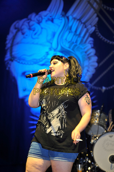 Beth Ditto of Gossip .performing at V Festival, Hylands Park, Chelmsford, Essex, England, UK, .18th August 2012..music live on stage concert half length black top t-shirt denim shorts microphone singing anchor tattoo .CAP/MAR.© Martin Harris/Capital Pictures.
