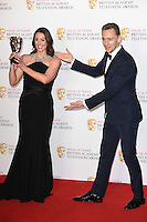 Suranne Jones and Tom Hiddlestone<br /> in the winners room at the 2016 BAFTA TV Awards, Royal Festival Hall, London<br /> <br /> <br /> &copy;Ash Knotek  D3115 8/05/2016