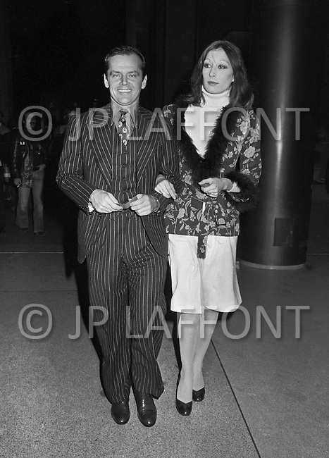 Madison Square Garden, Manhattan, New York City, NY. January 28th, 1974. Jack Nicholson and Anjelica Houston at Madison Square Garden to see the rematch between Muhammad Ali and Joe Frazier.