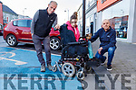 Noah and Megan Enright with Cllr Tom Barry highlighting safety issues with the footpath kerbs and disabled parking spaces in Market Street, Listowel on Tuesday.