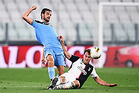 20th July 20202, Allianz Stadium, Turin, Italy; Serie A football league, Juventus versus Lazio; Marco Parolo is slide tackled by Aaron Ramsey of Juventus