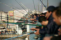 Hobby fishermen on the Galata Bridge, Istanbul, Turkey