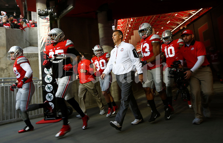 Ohio State Buckeyes head coach Urban Meyer and his players head out on to the field for warm ups before the college football game between the Ohio State Buckeyes and the Michigan State Spartans at Ohio Stadium in Columbus, Saturday afternoon, November 21, 2015. (The Columbus Dispatch / Eamon Queeney)