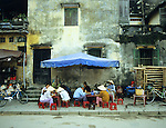 Hoi An Noodle Stall 02 - Customers eating at a pho noodle stall in Hoi An, Viet Nam