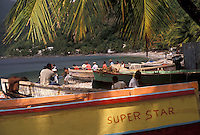 AJ2490, Dominica, Caribbean, Caribbean Islands, Local fishermen working in boats on the beach at Scotts Head on the island of Dominica.