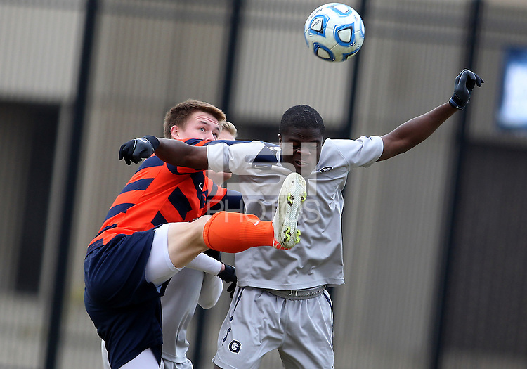 WASHINGTON, DC - NOVEMBER 25, 2012: Melvin Snoh (21) of Georgetown University almost gets booted in the face by Jordan Vale (2) of Syracuse University during an NCAA championship third round match at North Kehoe field, in Georgetown, Washington DC on November 25. Georgetown won 2-1 after overtime and penalty kicks.