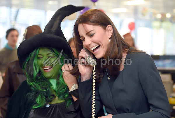 09 December 2015 - London, England - Kate Duchess of Cambridge Catherine Katherine Middleton with trader Nigel Halligan at ICAP's 23rd annual Charity Day. They join ICAP's brokers in its London office to speak to customers to close deals and help boost trading volumes during the day. Photo Credit: Alpha Press/AdMedia