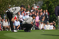 Straffin Co Kildare Ireland. K Club Ruder Cup...American Ryder Cup team members Tiger Woods and Jim Furyk line up their putt on the 14th green on the opening fourball session on the first day of the 2006 Ryder Cup, at the K Club in Straffan, Co Kildare, in the Republic of Ireland, 22 September 2006..Photo: Eoin Clarke/ Newsfile..