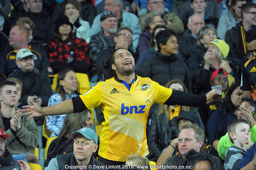 Fans celebrate Beauden Barrett's try during the Super Rugby match between the Hurricanes and Chiefs at Westpac Stadium, Wellington, New Zealand on Saturday, 23 April 2016. Photo: Dave Lintott / lintottphoto.co.nz