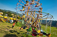 Ferris wheel at a village fair (San Salvador, El Salvador)