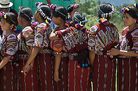 Schoolgirls queuing for drinks at the Independence Day celebrations in Chajul, Guatemala 2006.