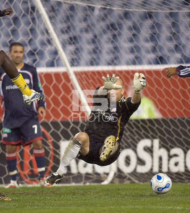 Matt Reis saves at close range (the shooter's foot at left). NE Revolution defeat Columbus Crew, 1-0, at Gillette Stadium.