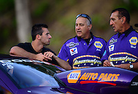 Jun. 15, 2012; Bristol, TN, USA: NHRA pro stock driver Vincent Nobile (left) talks with his father John Nobile (center) and a crew member during qualifying for the Thunder Valley Nationals at Bristol Dragway. Mandatory Credit: Mark J. Rebilas-