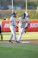 July 7, 2009: Tri-City Dust Devils' Jeremiah Sammy rounds third base past manager Fred Ocasio after hitting a home run during a Northwest League game against the Salem-Keizer Volcanoes at Volcanones Stadium in Salem, Oregon.  Sammy hit two home runs during the game.