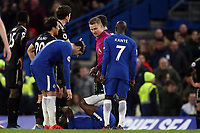 Victor Moses of Chelsea lies injured after a tackle by Ben Chilwell of Leicester city which the offender was shown a red card during Chelsea vs Leicester City, Premier League Football at Stamford Bridge on 13th January 2018