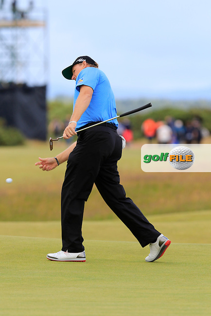 Ernie ELS (RSA) throws his ball to the crowd on the 15th green during Sunday's Round  of the 144th Open Championship, St Andrews Old Course, St Andrews, Fife, Scotland. 19/07/2015.<br /> Picture Eoin Clarke, www.golffile.ie