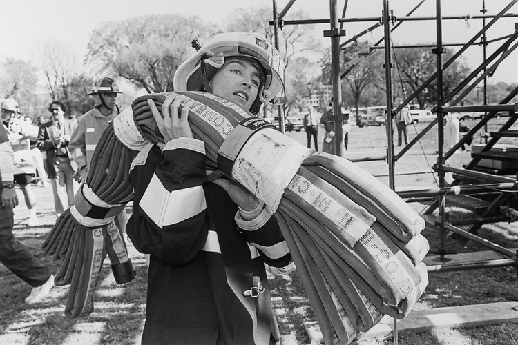 Rep. Blanche Lincoln, D-Ark. carries a fire hose up steps for the Democratic team on April 29, 1993. (Photo by Laura Patterson/CQ Roll Call)