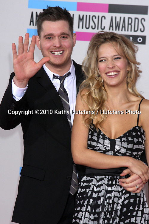 LOS ANGELES - NOV 21:  Michael Buble' & Fiance arrives at the 2010 American Music Awards at Nokia Theater on November 21, 2010 in Los Angeles, CA
