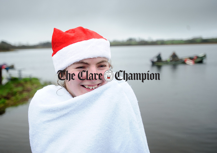Sinead Reidy tries to warm up following the annual Christmas day swim at Gortglas  Lake, Kildysart in aid of the West Clare Mini Marathon Cancer fund. Photograph by John Kelly.