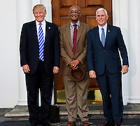 United States President-elect Donald Trump (L) and Vice President-elect Mike Pence (R) pose with Bob Woodson (C) at the clubhouse of Trump International Golf Club, November 19, 2016 in Bedminster Township, New Jersey. <br /> Credit: Aude Guerrucci / Pool via CNP /MediaPunch