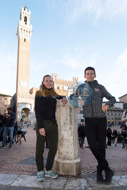 Last year's winners Tiesj Benoot (BEL) Lotto-Soudal and World Champion Anna Van der Breggen (NED) Boels Dolmans pose for pictures in Il Campo Siena finish line of the 2019 Strade Bianche running 184km from Siena to Siena, held over the white gravel roads of Tuscany, Italy. 8th March 2019.<br /> Picture: LaPresse/Fabio Ferrari | Cyclefile<br /> <br /> <br /> All photos usage must carry mandatory copyright credit (© Cyclefile | LaPresse/Fabio Ferrari)