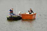 Craig Hetherington takes a turn at the kip in the skip with Dave Sheeran in the dinghy www.newsfile.ie