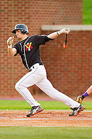 Berkley Hawkins #26 of the VMI Keydets follows through on his swing against the High Point Panthers at Willard Stadium on March 31, 2012 in High Point, North Carolina.  The Panthers defeated the Keydets 2-0.  (Brian Westerholt/Four Seam Images)