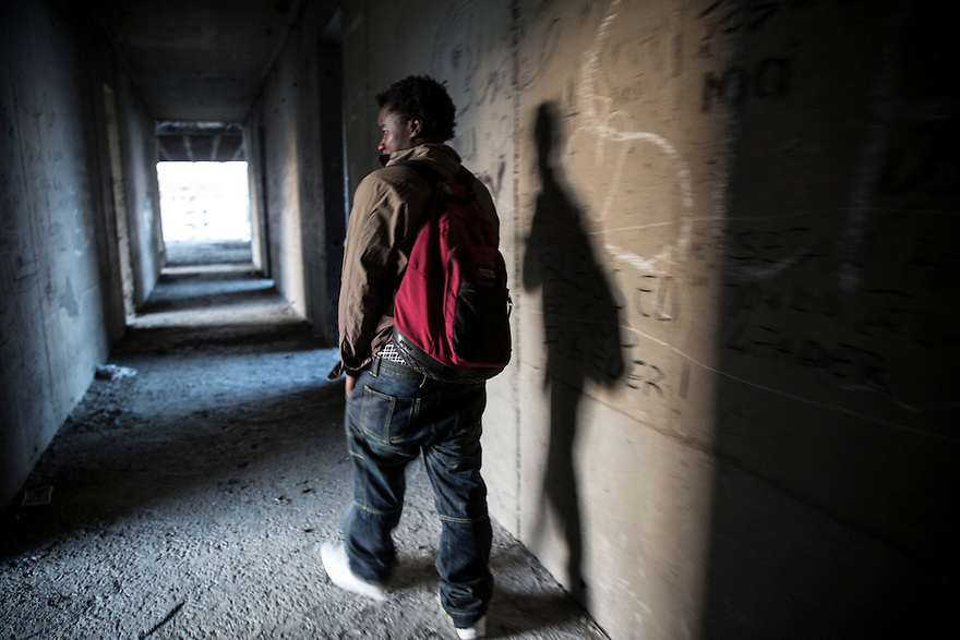 "SOFIA, BULGARIA- Mutebi Swaleh Rajabs from Uganda inside ""The Ritz"" an unfinished hotel building where he and other migrants have sheltered in the past."