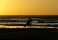 Costa Rica - file Photo -Tamarindo ,surfer at dawn