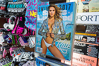 The Sports Illustrated 2017 swimsuit issue of the magazine is seen with other magazines displayed in a newsstand in New York on Wednesday, February 15, 2017. This year the magazine boasts three separate covers all featuring model Kate Upton. Upton also appeared on the 2012 and 2013 covers. (© Richard B. Levine)