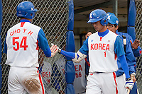 14 September 2009: Second base Myung-Gu Kang of South Korea congratulates first base Young-Hun Cho of South Korea during the 2009 Baseball World Cup Group F second round match game won 15-5 by South Korea over Great Britain, in the Dutch city of Amsterdan, Netherlands.