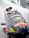 18 December 2010: Elfje Willemsen crosses the finish line, finishing in 14th place for Belgium at the Viessmann FIBT World Cup Bobsled Championships on Mount Van Hoevenberg in Lake Placid, New York, USA. Mandatory Credit: Ed Wolfstein Photo