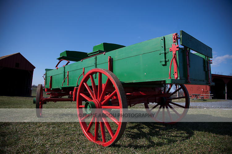 At the Agricultural History Farm Park in Derwood, Maryland, a green and red wagon lends an old-time feel to couples seeking a rustic wedding theme.  The Agricultural History Farm Park is a wedding and event venue operated by Montgomery County Parks.