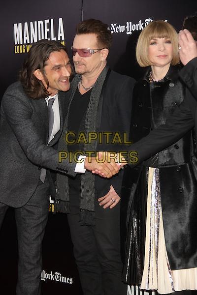 NEW YORK, NY - NOVEMBER 25: Justin Chadwick, Bono (Paul David Hewson) of U2, Anna Wintour at 'Mandela: Long Walk To Freedom' screening at Ziegfeld Theater on November 25, 2013 in New York City, NY., USA.<br /> CAP/MPI/RW<br /> &copy;RW/ MediaPunch/Capital Pictures