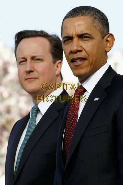 U.S. President Barack Obama (R) and British Prime Minister David Cameron participate in an official arrival ceremony on the South Lawn of the White House March 14, 2012 in Washington, DC. Prime Minister Cameron is on a three-day visit to the U.S. and he is expected to have talks with Obama on the situations in Afghanistan, Syria and Iran.  .headshot portrait black suit.CAP/ADM/CS.©Chip Somodevilla/Pool/CNP/AdMedia/Capital Pictures.