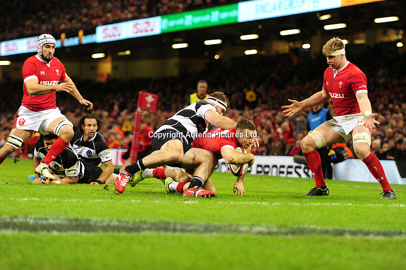 Wales Gareth Davies scores his sides sixth try during the International friendly match between Wales and Barbarians at the Principality Stadium in Cardiff, Wales, UK. Saturday 30 November 2019.